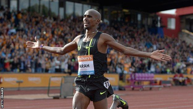 Mo Farah celebrates winning the Mens 2 mile during the Sainsbury's Birmingham Grand Prix in 2014