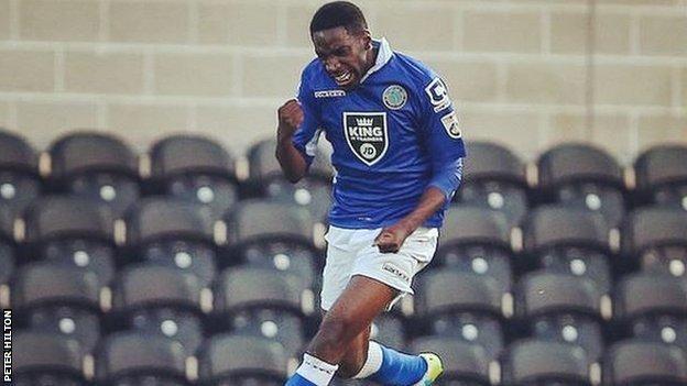 Adriano Moke celebrates scoring against Barnet