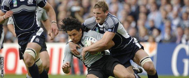 Scotland's John Barclay tackles Doug Howlett of New Zealand