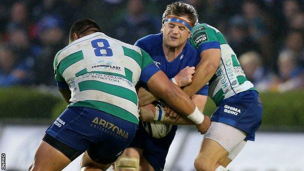 Leinster captain Jamie Heaslip is tackled by Mat Luamanu and Edoardo