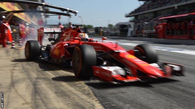 Sebastian Vettel leaves the pit lane