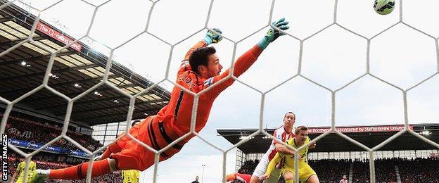 Stoke City midfielder Charie Adam scores against Tottenham