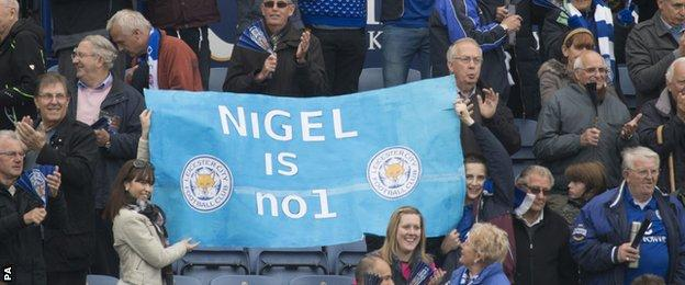 Leicester supporters hold up a banner praising manger Nigel Pearson