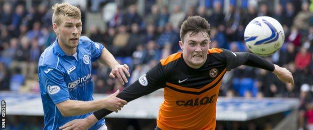 Dundee United's John Souttar (right) battles for the ball against St Johnstone's David Wotherspoon