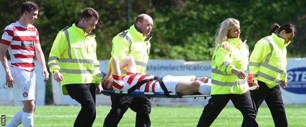 Hamilton Academical defender Mikey Devlin is stretchered off the field