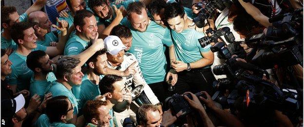 Nico Rosberg celebrates with his Mercedes team