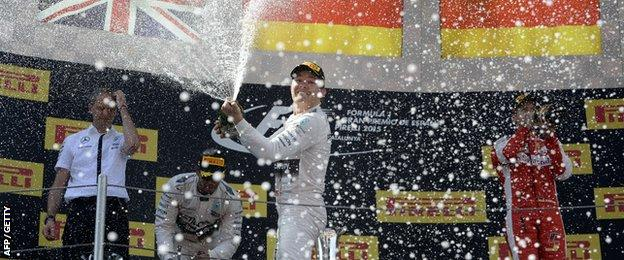 Nico Rosberg, Lewis Hamilton and Sebastian Vettel celebrate