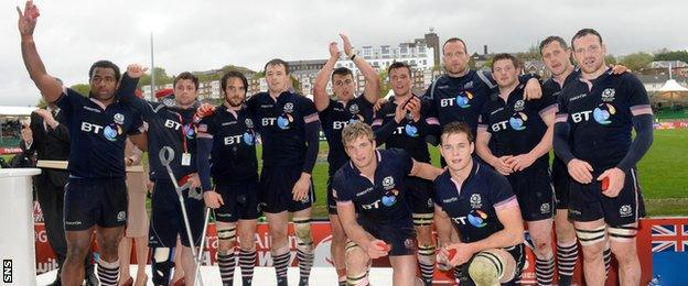 The Scotland players wave to the stand after being defeated in the Plate Final