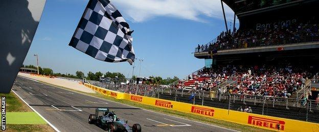 Nico Rosberg crosses the finish line
