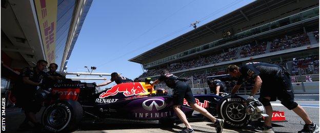 Red Bull engineers push Daniil Kvyat car back in to the garage