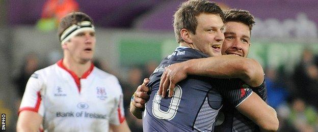 Dan Biggar congratulates Ospreys try-scorer Rhys Webb in December's game against Ulster