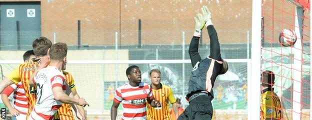 Hamilton's Greg Docherty watches his header hit the back of the net