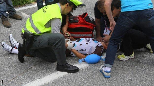 "Italian rider Domenico Pozzovivo receives medical treatment after his fall during the third stage of the 98th Giro d""Italia"