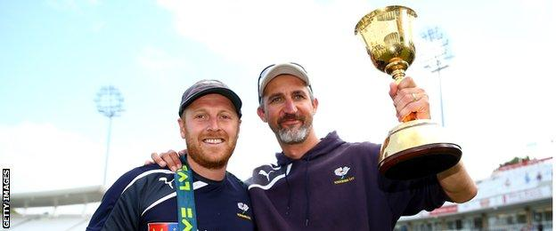 Former Australia bowler Jason Gillespie (right) celebrates County Championship success with Yorkshire's Andrew Gale