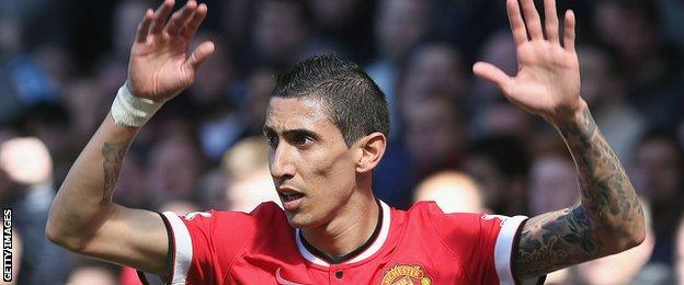 Angel Di Maria raises his arms playing for Man Utd against Everton in a recent Premier League game
