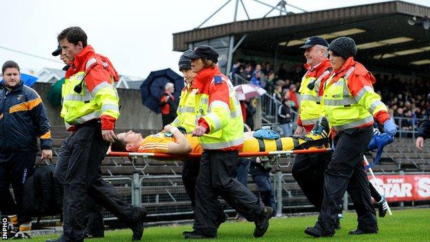 Aaron Graffin is stretchered off at Cusack Park