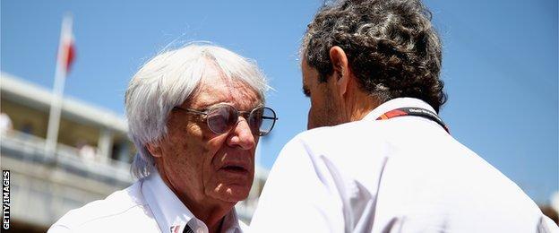 Bernie Ecclestone speaking to former driver Alain Prost