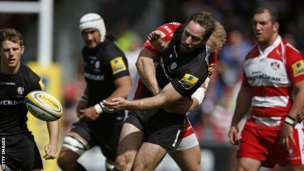 Matt Kvesic tackles Tomas O'Leary