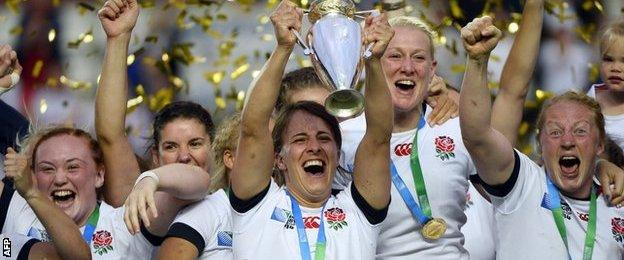 England captain Katy McLean lifts the trophy after the 2014 World Cup triumph