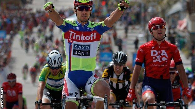 Peter Sagan (left) celebrates victory from Wouter Wippert (right) with Mark Cavendish (centre) third