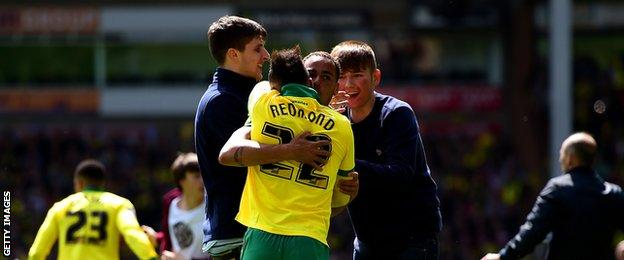Nathan Redmond and Elliott Bennett celebrate with Norwich fans after the final whistle