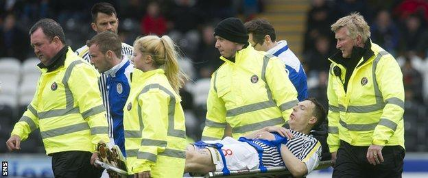 S Mirren's Alan Gow is stretchered off against Motherwell