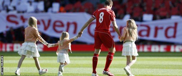 Steven Gerrard and his family on the pitch at Anfield