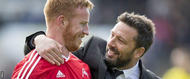 Derek McInnes (right) was delighted with striker Adam Rooney who scored his 28th goal of the season