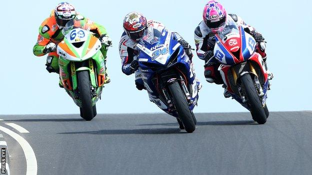 Alastair Seeley (centre) battles with Glenn irwin and Lee Johnston in an exciting Supersport race