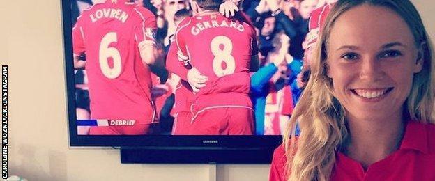Caroline Wozniacki watches Liverpool on TV
