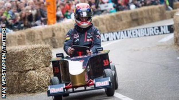 Toro Rosso's Max Verstappen of Scuderia drives a soapbox car during the Red Bull Soapbox Race in Valkenburg.