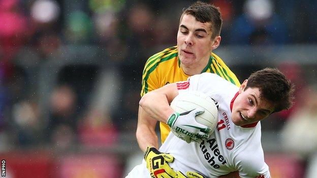 Donegal's Michael Carroll battles with Tyrone's David Mulgrew in the Ulster Minor game