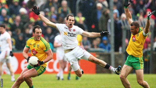 Donegal captain Michael Murphy comes under pressure from Justin McMahon