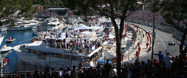 Fans watch from the harbourside at the Monaco Grand Prix