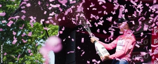 Australia's Simon Clarke celebrates taking the overall lead of the Giro after stage four