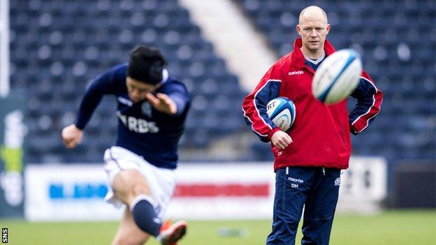 Duncan Hodge watches Greig Laidlaw practise his kicking