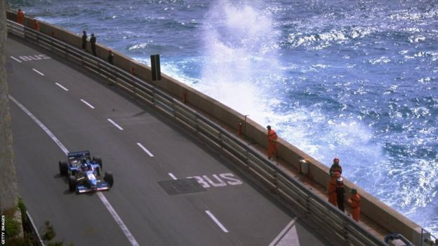 Jean Alesi of France races along the seafront in his Benetton-Renault during the Monaco Grand Prix in Monte Carlo