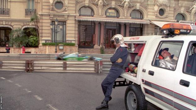 EMERGENCY SERVICES TAKE A BREAK WHILE ON STANDBY DURING THE FINAL DAY OF PRACTICE FOR THE MONACO GRAND PRIX