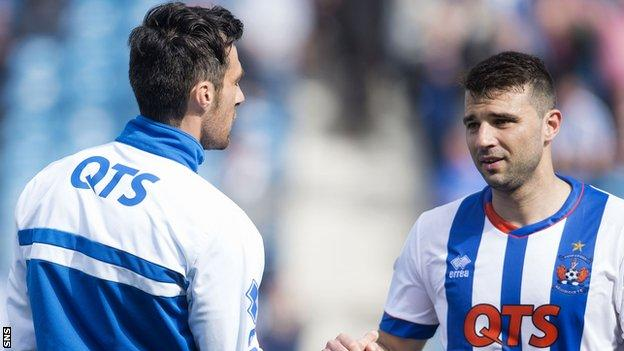 Alexei Eremenko (right) shakes hands with Kilmarnock team-mate Manuel Pascali at full-time.