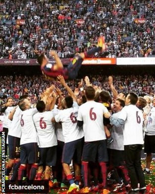 Xavi is given the bumps