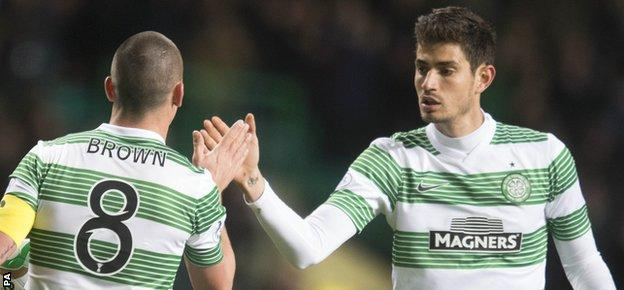 Nir Bitton (right) says he's happy at Celtic