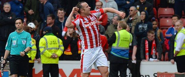 Stoke midfielder Charlie Adam celebrates scoring against Liverpool