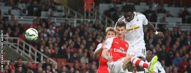 Bafetimbi Gomis heads in the winner against Arsenal at the Emirates Stadium