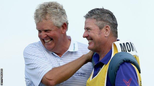 Colin Montgomerie (left) and his caddie Alastair McLean celebrate after winning the Senior PGA Championship