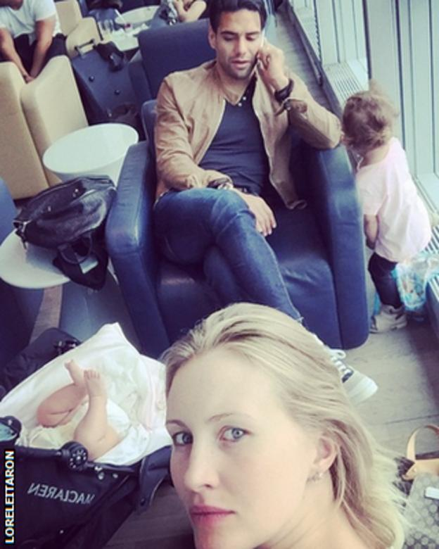 Radamel Falcao, his wife Lorelei Taron and their two children in an airport departure lounge