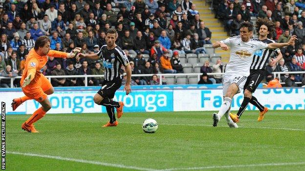 Jack Cork in action for Swansea City against Newcastle United