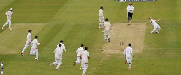 Ben Stokes (left) celebrates taking a wicket