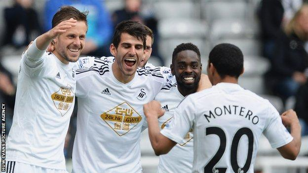 Gylfi Sigurdsson, Nelson Oliveira and Nathan Dyer celebrate a goal in the away win against Newcastle United with Jefferson Montero