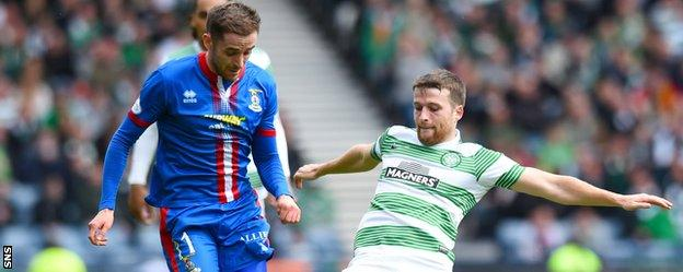 Nick Ross is tackled by Celtic's Adam Matthews