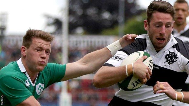 Ireland winger Craig Gilroy cannot prevent Alex Cuthbert scoring the opening try for the Barbarians
